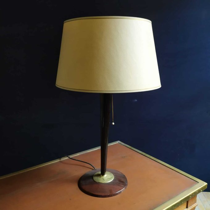 Vintage lamp with wooden base and glass dish.